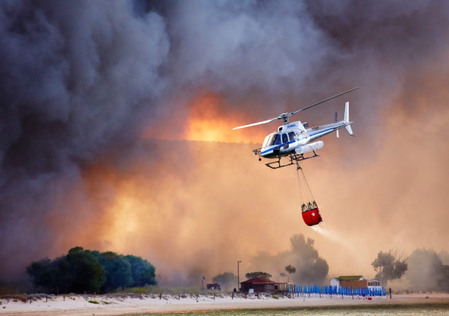 Helicopter in bush fire in Sardinia