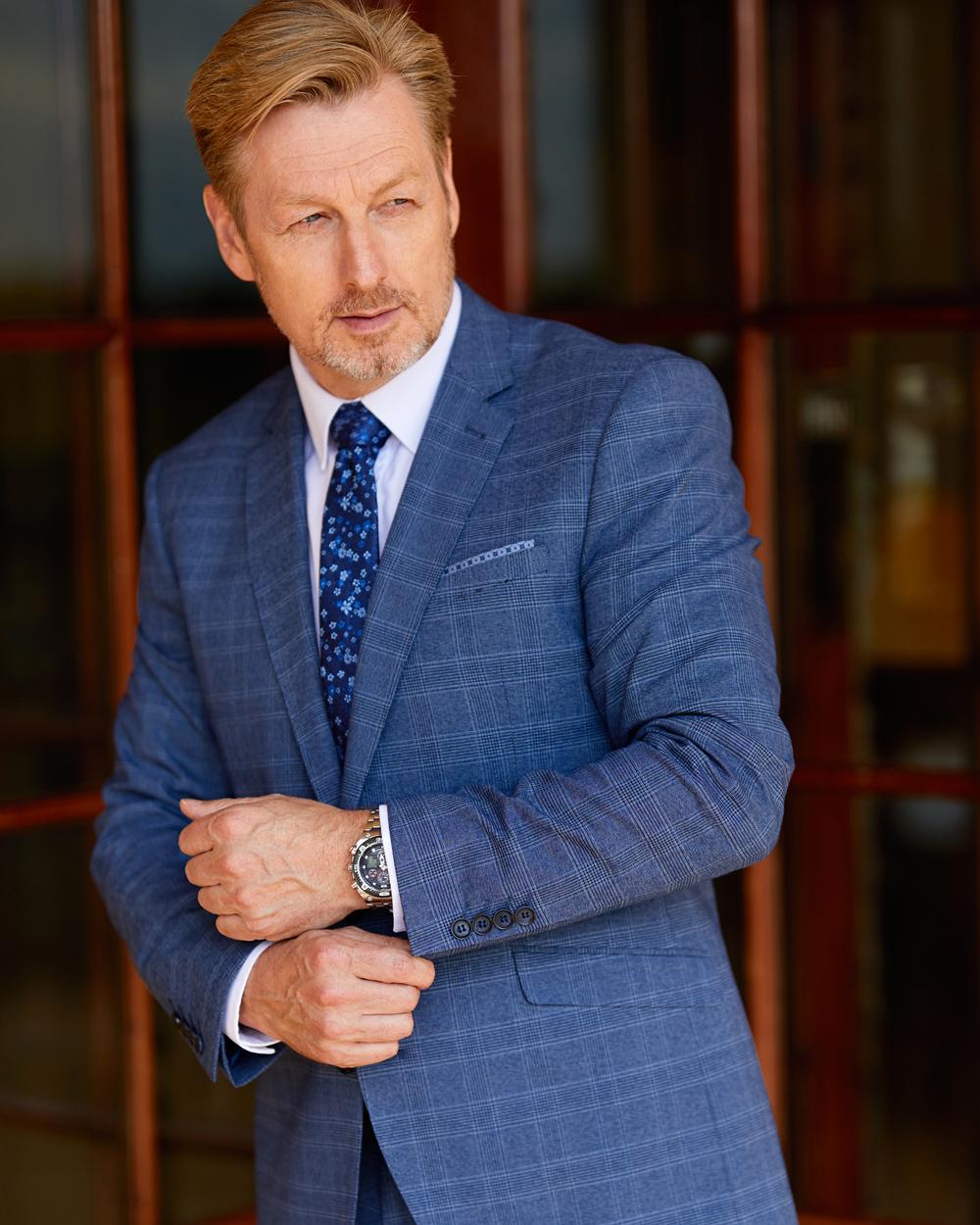 Man in smart blue suit